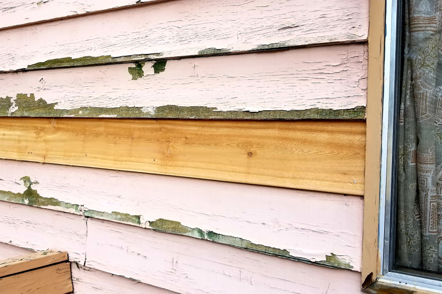 old worn out siding on home